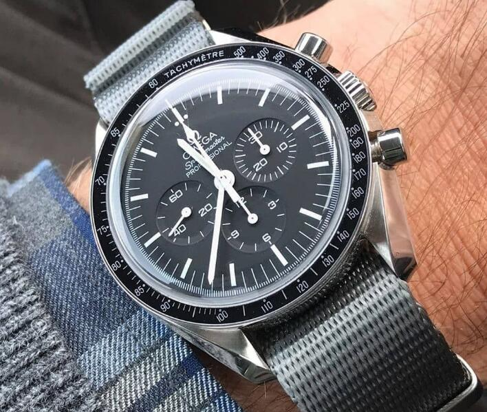 The hands and hour markers are striking on the black dial.